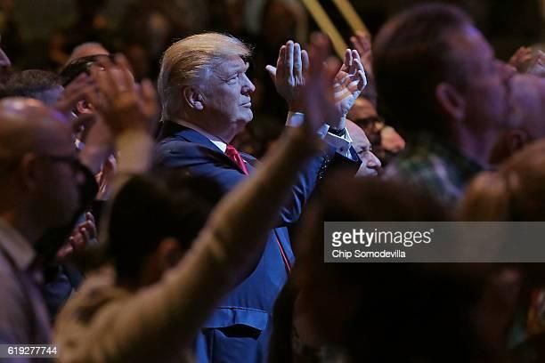 Republican presidential nominee Donald Trump attends a worship service at the International Church of Las Vegas October 30 2016 in Las Vegas Nevada...