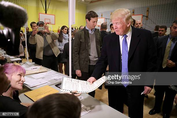 Republican presidential nominee Donald Trump collects his ballot with his soninlaw Jared Kushner on Election Day at PS 59 November 8 2016 in New York...