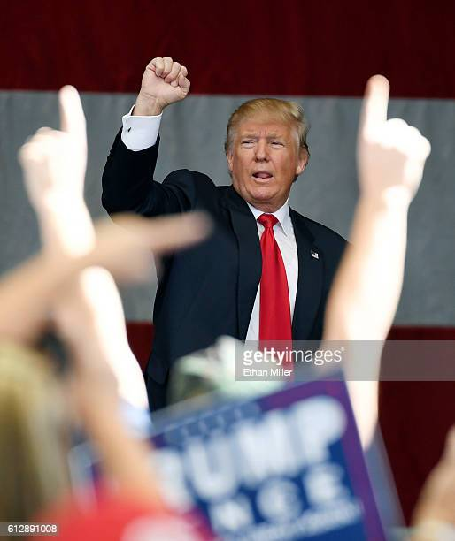 Republican presidential nominee Donald Trump gestures as he leaves a campaign rally at the Henderson Pavilion on October 5 2016 in Henderson Nevada...