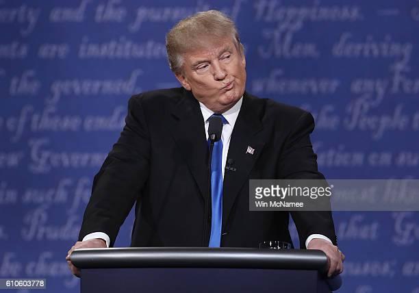 Republican presidential nominee Donald Trump gestures during the Presidential Debate at Hofstra University on September 26 2016 in Hempstead New York...