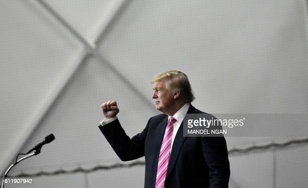 TOPSHOT Republican presidential nominee Donald Trump gestures following a rally at Spooky Nook Sports center in Manheim Pennsylvania on October 1...