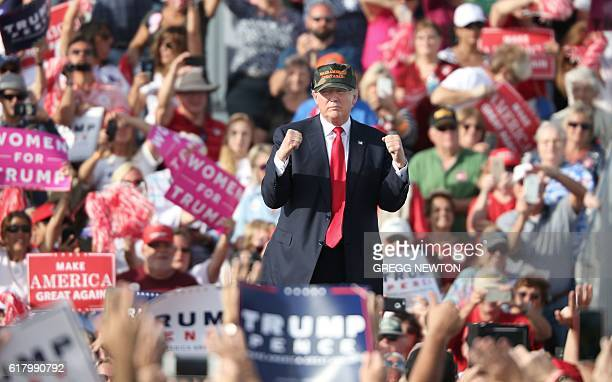 Republican presidential nominee Donald Trump gestures to supporters at a rally on the tarmac of the OrlandoSanford International Airport in Sanford...