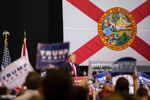 Republican presidential nominee Donald Trump gives a double thumbs up after speaking to a boisterous crowd at a rally at the Florida State...