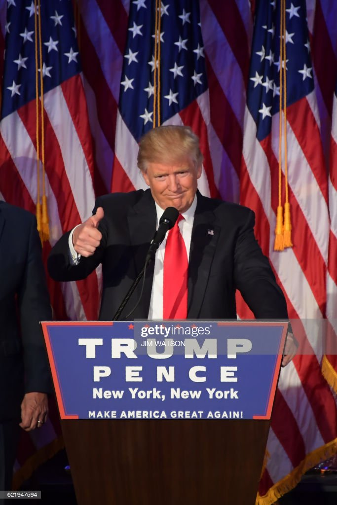Republican presidential nominee Donald Trump gives a speech during election night at the New York Hilton Midtown in New York on November 8, 2016. Republican presidential elect Donald Trump stunned America and the world November 9, riding a wave of populist resentment to defeat Hillary Clinton in the race to become the 45th president of the United States. / AFP / JIM