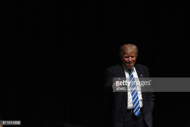 US Republican presidential nominee Donald Trump gives a thumbs up during a campaign rally at the MidAmerica convention centre in Council Bluffs Iowa...