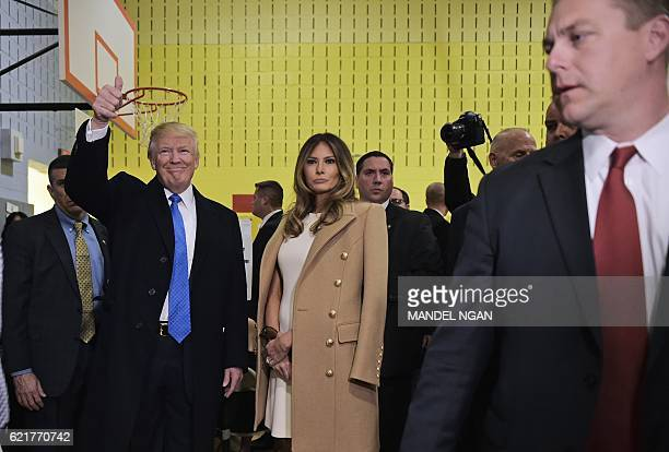 TOPSHOT Republican presidential nominee Donald Trump gives the thumbsup after he and his wife Melania submitted their ballots at a polling station in...