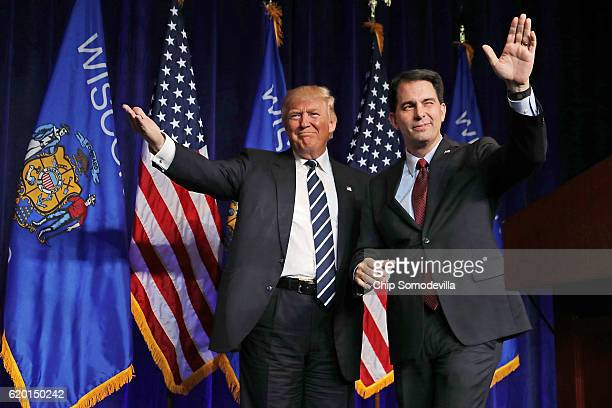 Republican presidential nominee Donald Trump is welcomed to the stage by Wisconsin Governor Scott Walker during a campaign rally at the WL Zorn Arena...