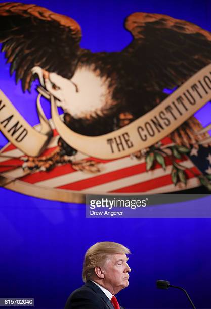 Republican presidential nominee Donald Trump listens to Democratic presidential nominee former Secretary of State Hillary Clinton speak during the...