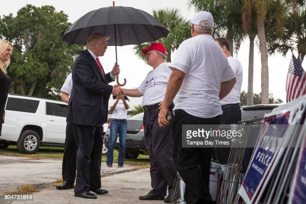 Republican presidential nominee Donald Trump meets supporters organizing voter registration and support for his campaign just before a rally at the...