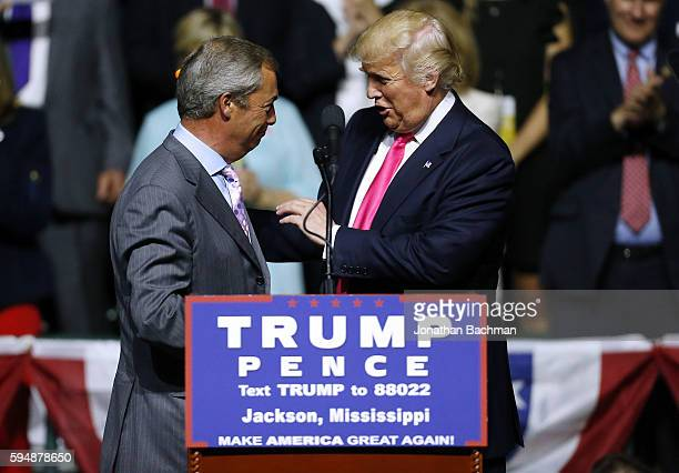 Republican Presidential nominee Donald Trump right greets United Kingdom Independence Party leader Nigel Farage during a campaign rally at the...