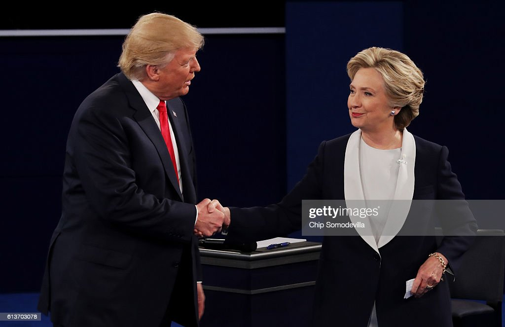 Republican presidential nominee Donald Trump shakes hands with Democratic presidential nominee former Secretary of State Hillary Clinton during the town hall debate at Washington University on October 9, 2016 in St Louis, Missouri. This is the second of three presidential debates scheduled prior to the November 8th election.