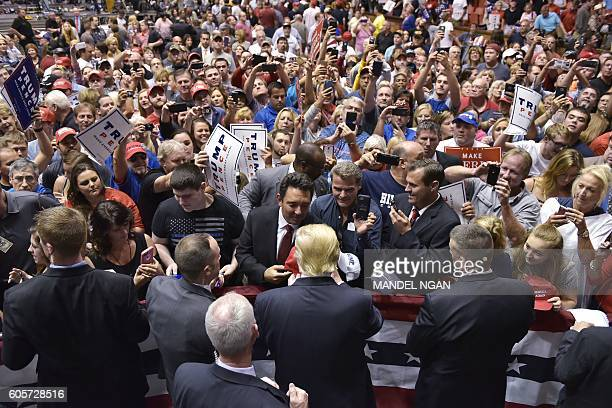 Republican presidential nominee Donald Trump signs autographs during a rally at the Canton Memorial Civic Center on September 14 2016 in Canton Ohio...