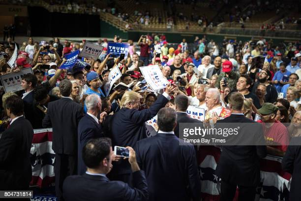 Republican presidential nominee Donald Trump signs autographs for supporters following a speech at a campaign rally at Silver Spurs Arena in...