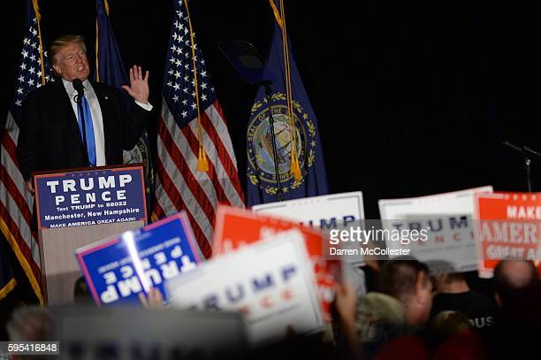 Republican presidential nominee Donald Trump speaks at a rally at the Radisson Hotel August 25 2016 in Manchester New Hampshire Speaking from a...