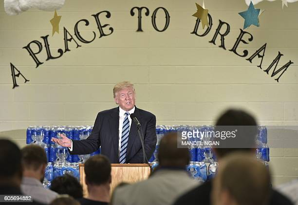 TOPSHOT Republican presidential nominee Donald Trump speaks at the Bethel United Methedoist Church on September 14 2016 in Flint Michigan / AFP /...