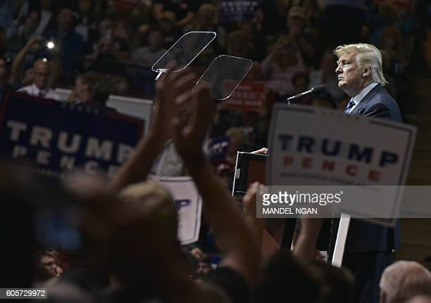 TOPSHOT Republican presidential nominee Donald Trump speaks during a rally at the Canton Memorial Civic Center on September 14 2016 in Canton Ohio /...