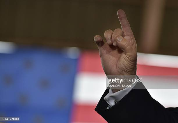 Republican presidential nominee Donald Trump speaks during a rally at the Southeastern Livestock Pavilion in Ocala Florida on October 12 2016 / AFP /...
