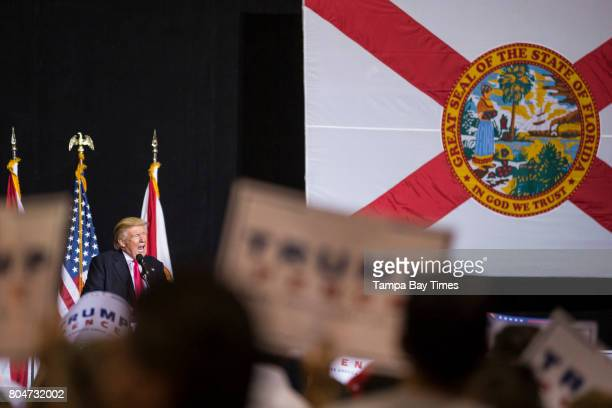 Republican presidential nominee Donald Trump speaks to a boisterous crowd at a rally at the Florida State Fairgrounds in Tampa Florida on Wednesday...