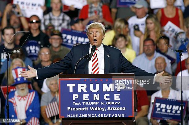 Republican presidential nominee Donald Trump speaks to a crowd of supporters during a campaign rally on October 4 2016 in Prescott Valley Arizona...