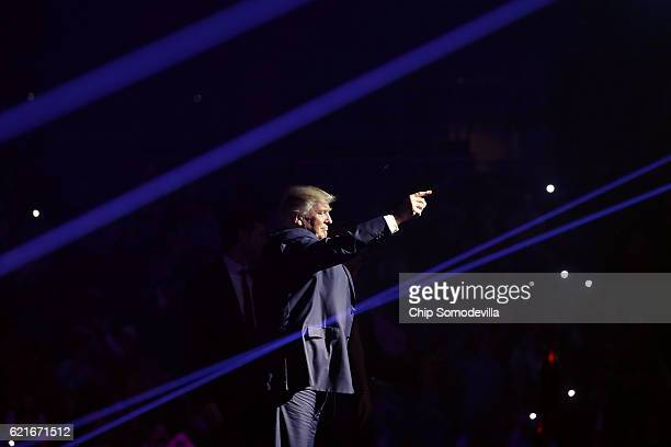 Republican presidential nominee Donald Trump takes the stage with laser lights during a campaign rally at the SNHU Arena November 7 2016 in...