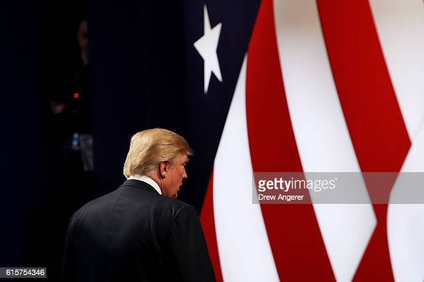 Republican presidential nominee Donald Trump walks off stage after the third US presidential debate at the Thomas Mack Center on October 19 2016 in...