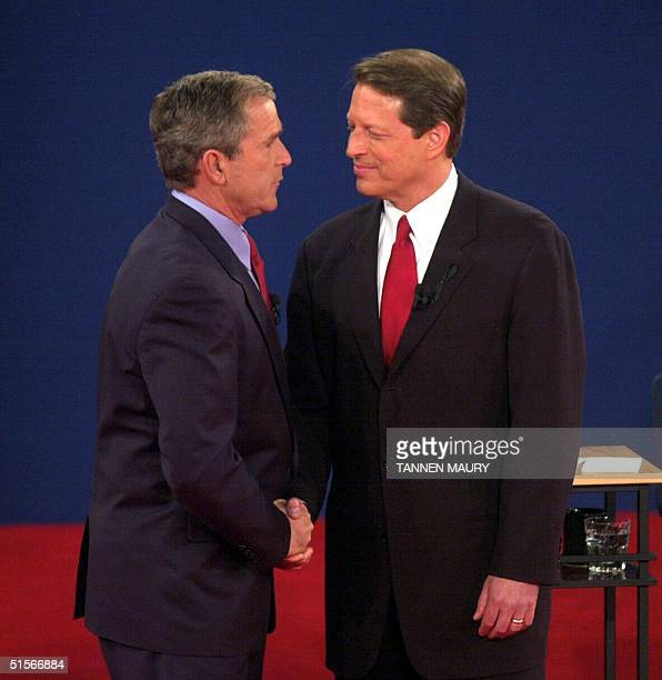 Republican presidential nominee George W Bush shakes hands with Democratic presidential nominee Al Gore after their third debate at Washington...