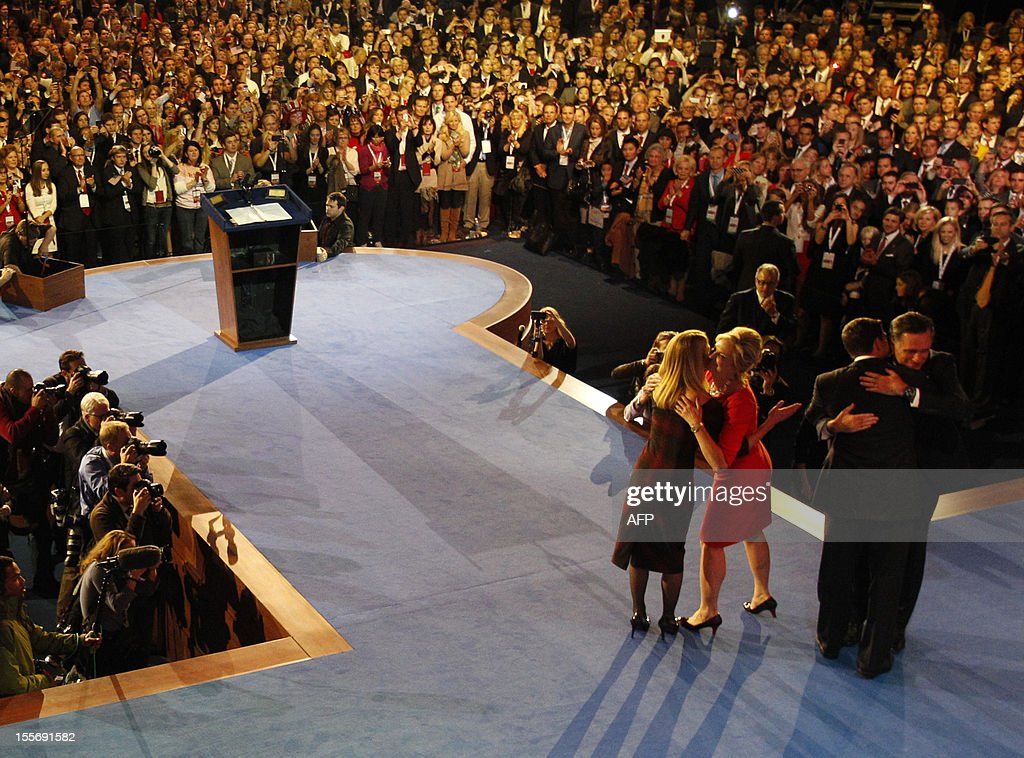 Republican presidential nominee Mitt Romney and running mate Paul Ryan embrace beside wives Ann Romney and Janna Ryan after Romney delivered his concession speech in Boston, Massachusetts, November 7, 2012. AFP PHOTO / Pool / Rick Wilking