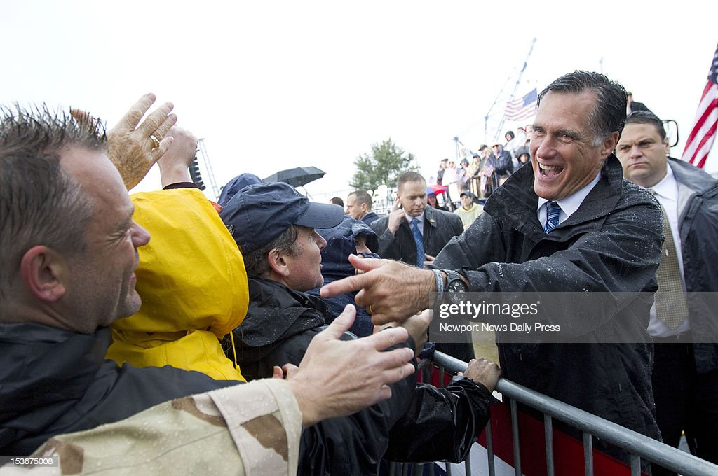 Republican presidential nominee Mitt Romney greets supporters after speaking at a campaign rally at Victory Landing Park in Newport News, Virginia, on Monday, October 8, 2012.
