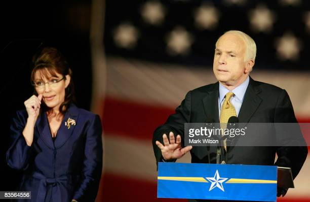 Republican presidential nominee US Sen John McCain with vicepresidential nominee Alaska Gov Sarah Palin by his side concedes victory during his...