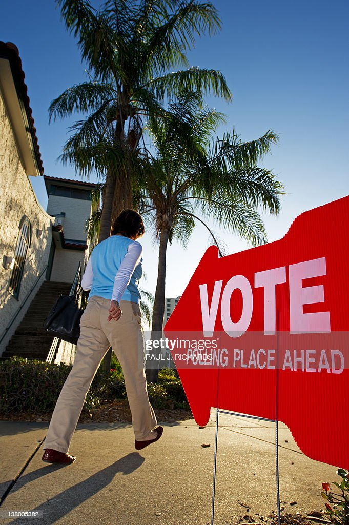 A Republican primary voter walks to her polling precinct #133, early January 31, 2012, at the Coliseum, in downtown St. Petersburg, Florida. AFP Photo/Paul J. Richards