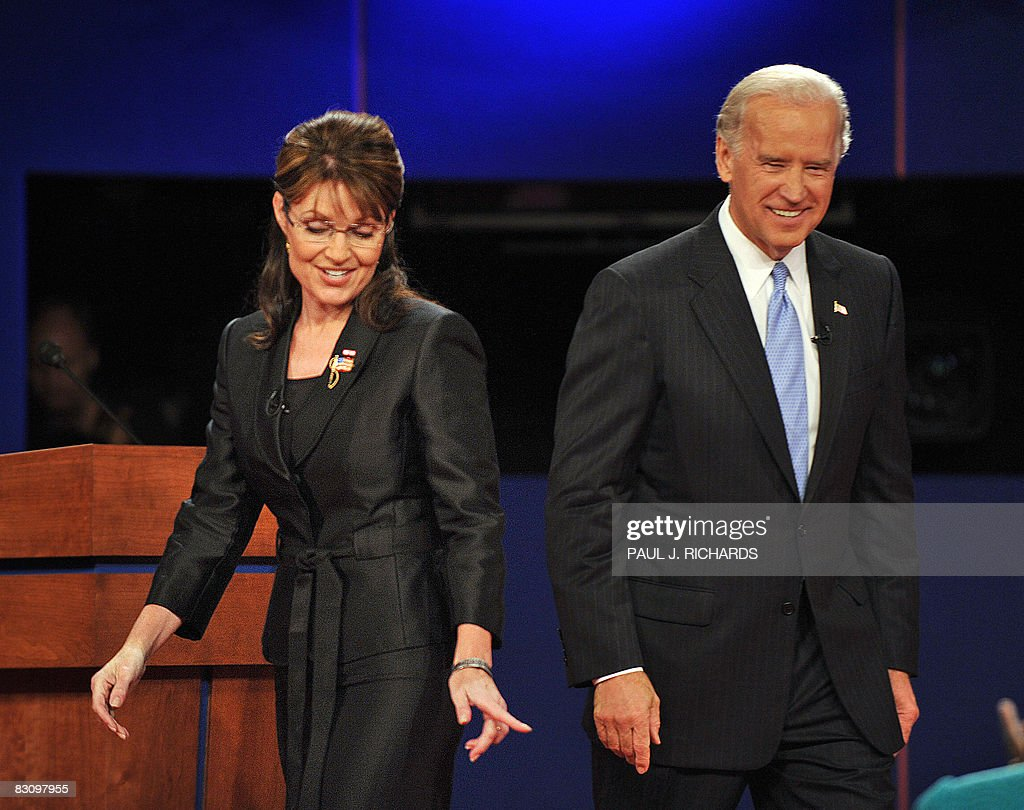 Republican Sarah Palin (L) and Democrat Joseph Biden (R) walk on stage following their vice presidential debate on October 2, 2008 at Washington University in St. Louis, Missouri. Vice presidential nominees Palin and Biden clashed at their crucial vice presidential debate, with the Alaska governor under pressure to quell questions about her knowledge and experience.