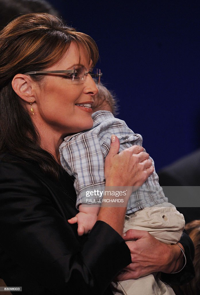 Republican Sarah Palin holds her infant son Trig following her vice presidential debate with Democrat Joseph Biden October 2, 2008 at Washington University in St. Louis, Missouri. Vice presidential nominees Palin and Biden clashed at their crucial vice presidential debate, with the Alaska governor under pressure to quell questions about her knowledge and experience. AFP PHOTO / Paul J. RICHARDS