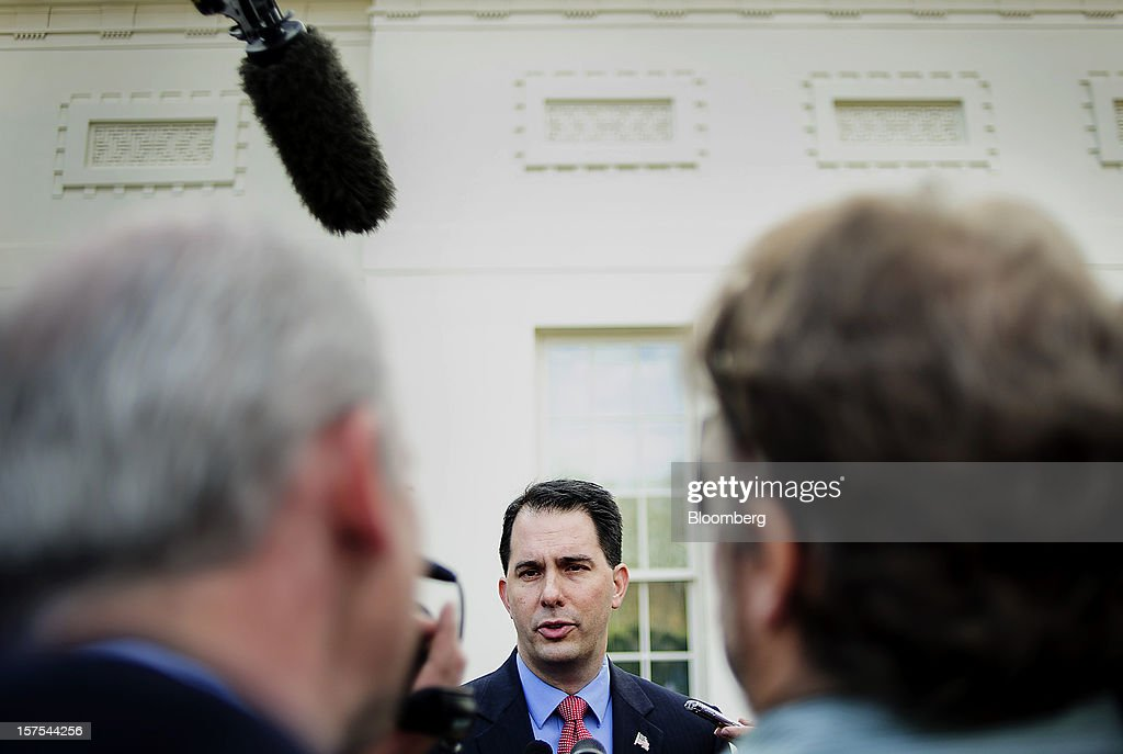 Republican <a gi-track='captionPersonalityLinkClicked' href=/galleries/search?phrase=Scott+Walker+-+Politician&family=editorial&specificpeople=7511934 ng-click='$event.stopPropagation()'>Scott Walker</a>, governor of Wisconsin, center, speaks to the media following a press conference after meeting with U.S. President Barack Obama in Washington, D.C., U.S., on Tuesday, Dec. 4, 2012. Negotiations over the so-called fiscal cliff are stalled as President Obama and Republicans trade offers on ways to avoid more than $600 billion in U.S. spending cuts and tax increases for 2013 that will start to take effect in January if Congress doesn't act. Photographer: Andrew Harrer/Bloomberg via Getty Images