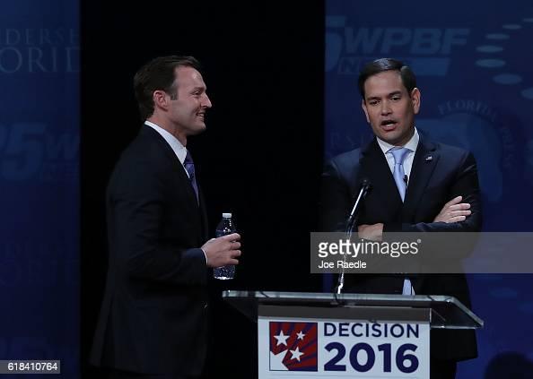 Republican Sen Marco Rubio and his Democratic challenger Rep Patrick Murphy speak during a break in their US Senate debate being held at Broward...