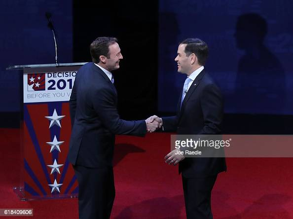Republican Sen Marco Rubio shakes hands with his Democratic challenger Rep Patrick Murphy before the start of their US Senate debate being held at...