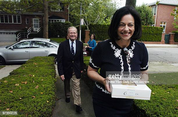 Republican Senate candidate Kathleen McFarland who carries an apple pie and former National Security Adviser Robert McFarlane visit the home of a...