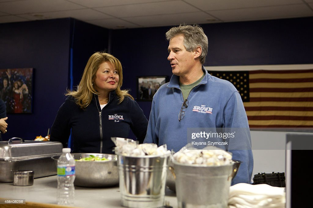 Republican Senate candidate Scott Brown (right) and wife Gail Huff greet supporters at the Manchester, NH GOP Victory office on November 4, 2014 in Manchester, New Hampshire. Brown is running in a tight race against opponent U.S. Sen. Jeanne Shaheen (D-NH).