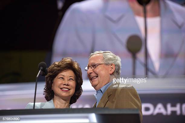 Republican Senator Mitch McConnell and his wife Elaine Chao check the podium the day before the start of the Republican National Convention at the...