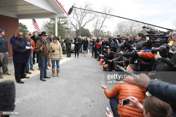 Republican Senatorial candidate Roy Moore and his wife Kayla Moore speak to the media after they leave the polling location setup in the Fire...