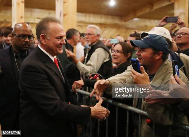 Republican Senatorial candidate Roy Moore arrives to speak during a campaign event at Jordan's Activity Barn on December 11 2017 in Midland City...