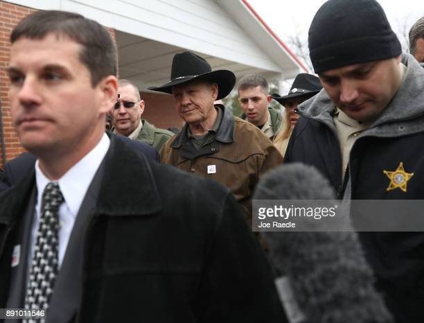 Republican Senatorial candidate Roy Moore exits after casting his vote at the polling location setup in the Fire Department on December 12 2017 in...