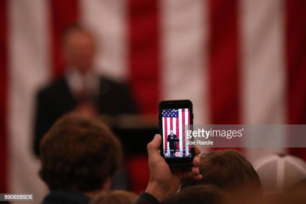 Republican Senatorial candidate Roy Moore is seen on cell phone screen as he speaks during a campaign event at Jordan's Activity Barn on December 11...