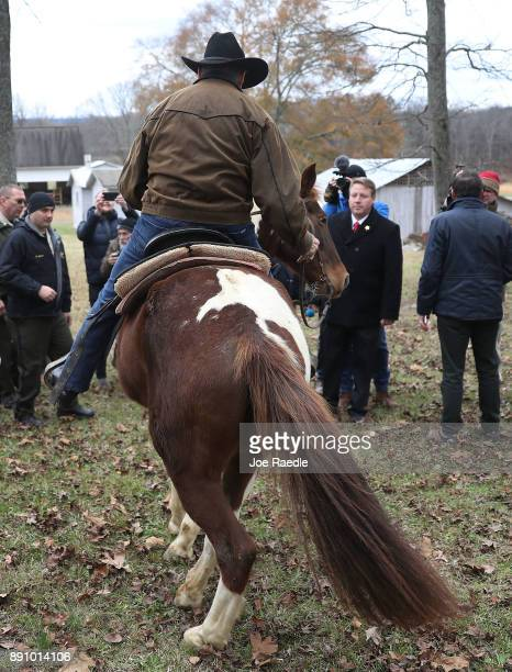 Republican Senatorial candidate Roy Moore rides his horse away after casting his vote at the polling location setup in the Fire Department on...