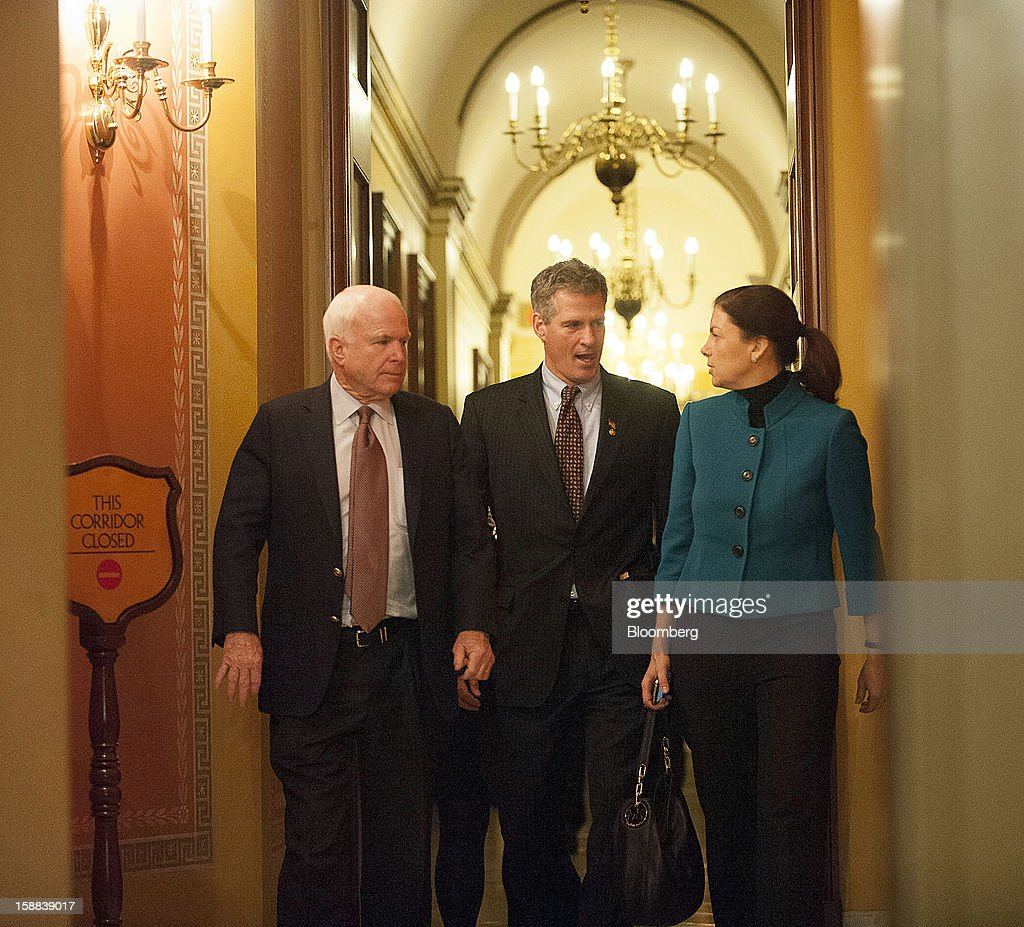 Republican Senators John McCain of Arizona, Scott Brown of Massachusetts, and Kelly Ayotte of New Hampshire leave a meeting of Republican senators at the U.S. Capitol in Washington, D.C., U.S., on Friday, Dec. 31, 2012. Senate Minority Leader Mitch McConnell, Republican of Texas, called the meeting to explain a fiscal cliff deal with the White House that the Senate is expected to vote on later tonight. Photographer: Jay Mallin/Bloomberg via Getty Images