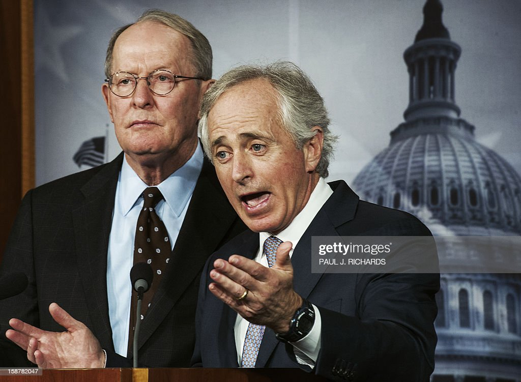 US Republican Senators Lamar Alexander (L) and Bob Corker speak on the impending 'fiscal cliff' during a media briefing on December 28, 2012 on Capitol Hill. US President Barack Obama will press top lawmakers for a deal to avert huge tax hikes and growth-sapping spending cuts next week, but hopes for an end to the fiscal cliff crisis appear thin. Wall Street reflected pessimism over prospects for a deal in bitterly divided and stalemated Washington, with the Dow Jones Industrial Average slipping 88.45 points or 0.68 percent an hour into trade. AFP PHOTO/Paul J. Richards