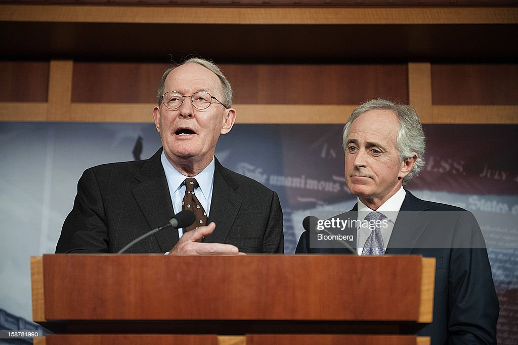 """Republican Senators Lamar Alexander, left, and Bob Corker, both from Tennessee, hold a news conference in Washington, D.C., U.S., on Friday, Dec. 28, 2012. President Obama should show leadership on averting a """"Medicare fiscal cliff,"""" and not just talk about taxing the rich, Alexander said. Photographer: Jay Mallin/Bloomberg via Getty Images"""