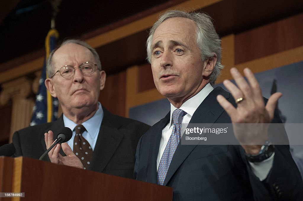 "Republican Senators Lamar Alexander, left, and Bob Corker, both from Tennessee, hold a news conference in Washington, D.C., U.S., on Friday, Dec. 28, 2012. President Obama should show leadership on averting a ""Medicare fiscal cliff,"" and not just talk about taxing the rich, Alexander said. Photographer: Jay Mallin/Bloomberg via Getty Images"