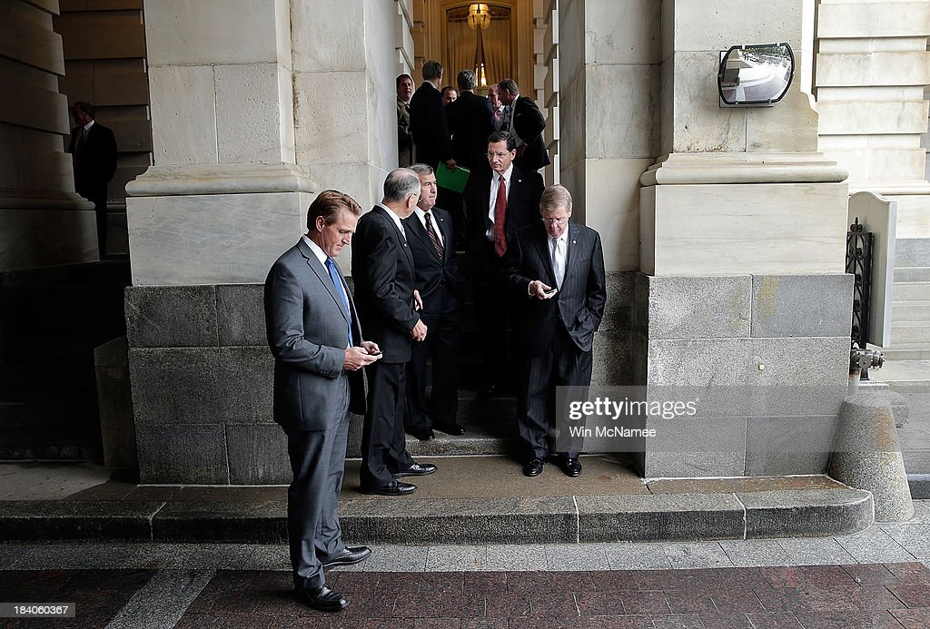 Republican senators wait at the U.S. Capitol for a shuttle bus ride to the White House for a meeting between Republican members of the U.S. Senate with U.S. President Barack Obama on settling the debt limit and government funding issues October 11, 2013 in Washington, DC. The U.S. government shutdown is entering its eleventh day as the U.S. Senate and House of Representatives remain gridlocked on funding the federal government. From left to right are Sen. Jeff Flake (R-AZ), Sen. Chuck Grassley (R-IA), Sen. Mike Johanns (R-NE), Sen. John Barrasso (R-WY), and Sen. Johnny Isakson (R-GA).