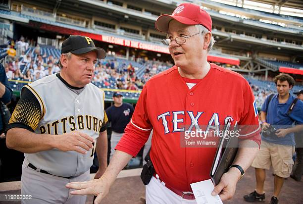 Republican team manager Rep Joe Barton RTexas right talks with Democratic team manager Mike Doyle DPa before the 50th Annual Congressional Baseball...