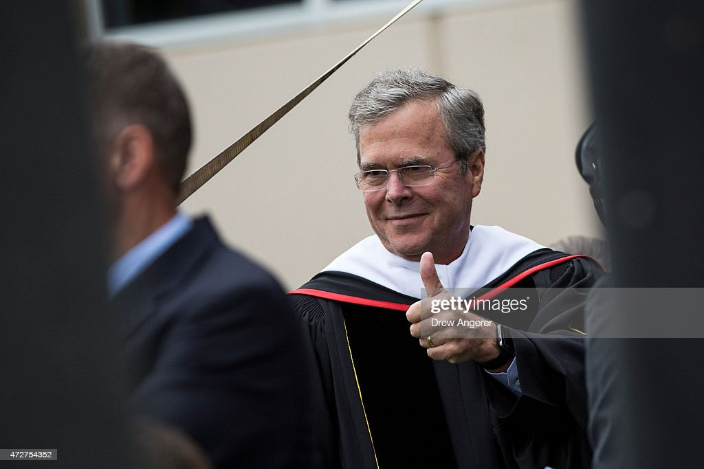 Republican US presidential hopeful and former Florida governor Jeb Bush gives a thumbs up while he waits to take the stage prior to delivering the...